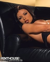 Veronika Zemanova is smothering hot as she sheds her tan leather suit and poses on a black couch.